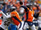 Former Denver Broncos quarterback Case Keenum attempts a pass against the Los Angeles Rams