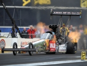 Top Fuel Dragster pilot Terry McMillen racing during the season-opener at Auto Club Raceway