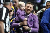 MMA fighter Conor McGregor with his son Conor McGregor Jr. at Super Bowl LIII
