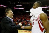 Houston Rockets general manager Daryl Morey celebrates a Houston Rockets win with former big man Dwight Howard