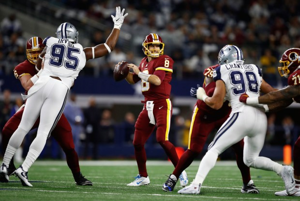Dallas Cowboys defensive ends David Irving and Tyrone Crawford attempt to get to Kirk Cousins against the Washington Redskins