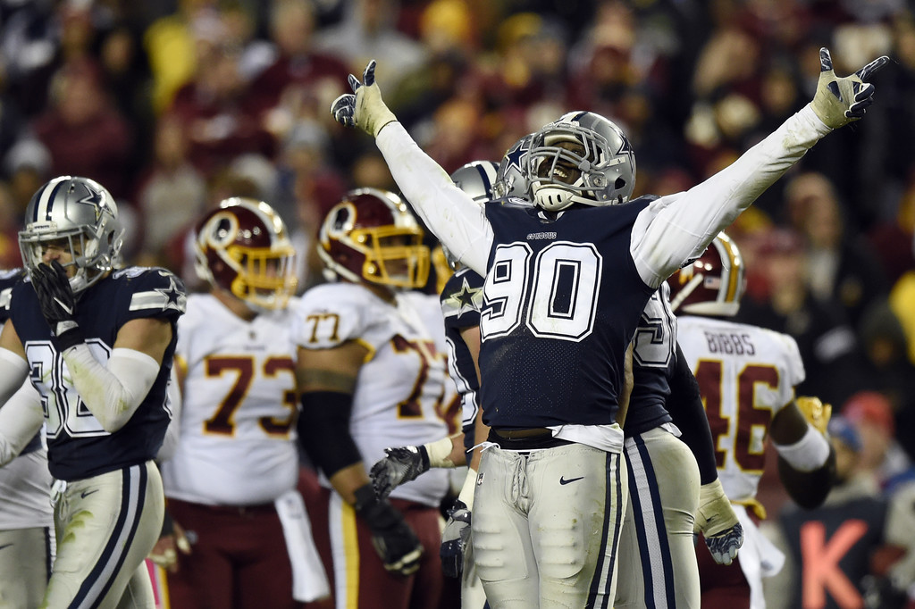 Dallas Cowboys defensive end DeMarcus Lawrence reacts after a play against the Washington Nationals