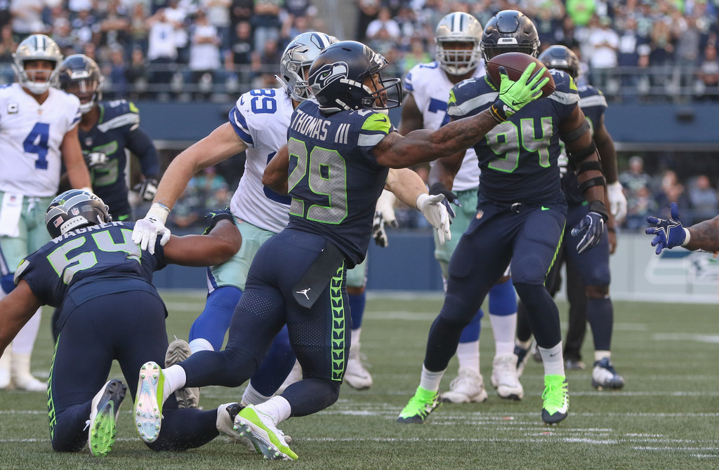 Former Seattle Seahawks safety Earl Thomas intercepts a pass against the Dallas Cowboys