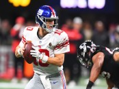 New York Giants quarterback Eli Manning looks to attempt a pass against the Atlanta Falcons