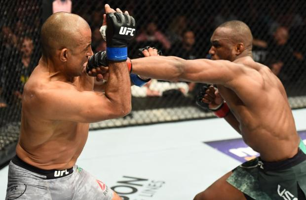 UFC fighter Kamaru Usman throwing a punch in a UFC fight