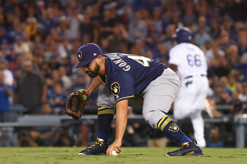 Former Milwaukee Brewers pitcher Gio González makes a play on the ball against the Los Angeles Dodgers in the 2018 NLCS
