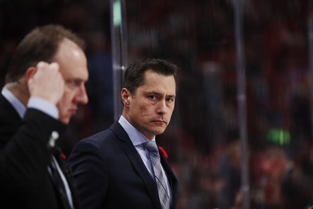 Former Ottawa Senators head coach Guy Boucher coaching on the bench from the 2017 SAP NHL Global Series against the Colorado Avalanche