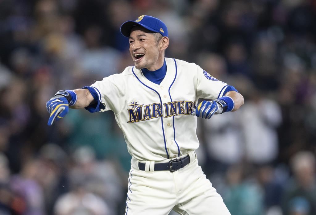 Baseball legend Ichirō Suzuki jokes around on the field after the game against the Texas Rangers
