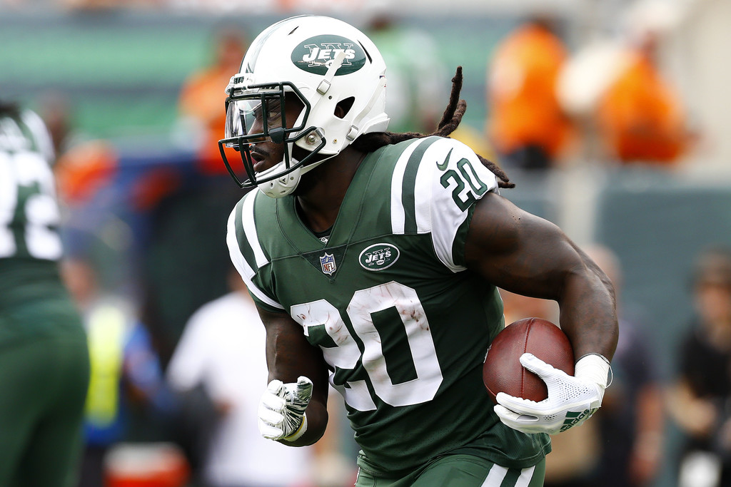 Former New York Jets running back Isaiah Crowell rushing the ball against the Denver Broncos