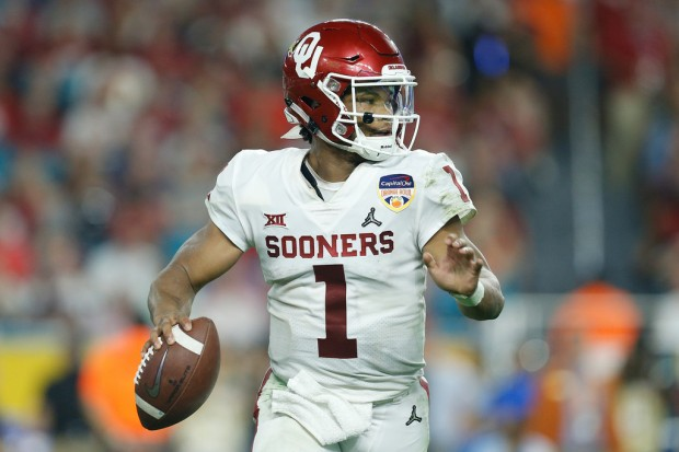 Former Oklahoma Sooners quarterback Kyler Murray looks to pass the football against the Alabama Crimson Tide in the 2018 College Football Playoff at the Capital One Orange Bowl
