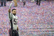 New England Patriots linebacker Kyle Van Noy reacts on the field after winning the Super Bowl against the Los Angeles Rams