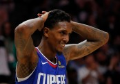 Los Angeles Clippers swingman Lou Williams reacts after a dunk on Alex Len against the Atlanta Hawks