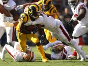 Los Angeles Rams running back Malcolm Brown rushes the ball against the San Francisco 49ers