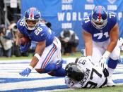 Former Jacksonville Jaguars defensive end Malik Jackson tackles Saquon Barkley near the goal line against the New York Giants