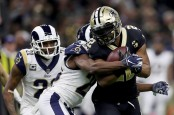 Former New Orleans Saints running back Mark Ingram is tackled after rushing the ball against the Los Angeles Rams in the NFC Championship game