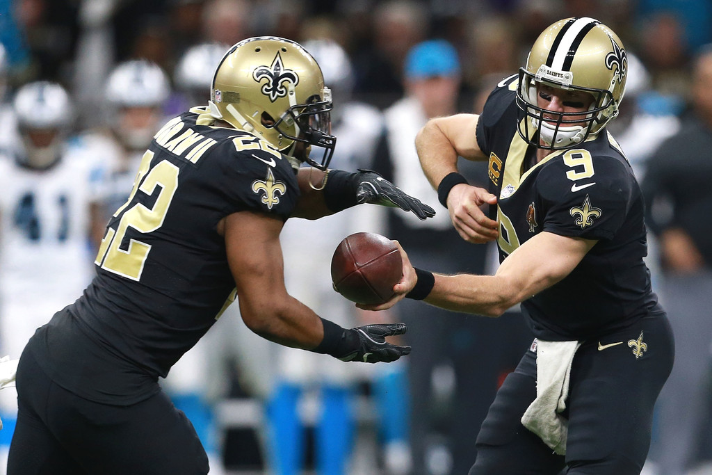 Former New Orleans Saints running back Mark Ingram receives a handoff from Drew Brees during the second half of the NFC Wild Card playoff game against the Carolina Panthers