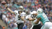 Former New Orleans Saints center Max Unger attempts to block Ndamukong Suh against the Miami Dolphins
