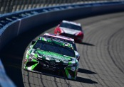 Driver Kyle Busch leads the pack of cars Monster Energy NASCAR Cup Series Auto Club 400