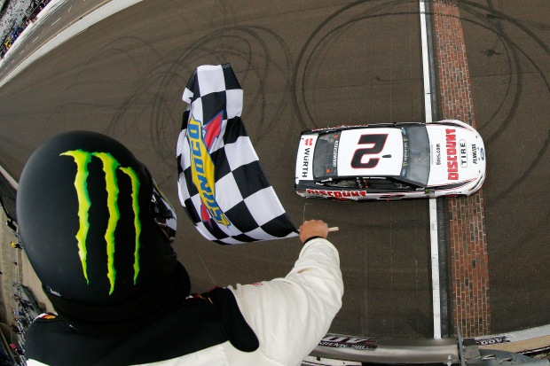 Driver Brad Keselowski crosses the finish line to win the Monster Energy NASCAR Cup Series Big Machine Vodka 400