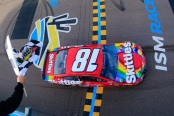 Kyle Busch takes the checkered flag to win the Monster Energy NASCAR Cup Series TicketGuardian 500 at ISM Raceway