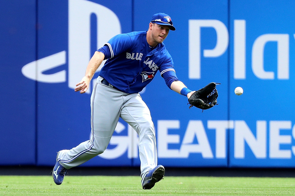 Former Toronto Blue Jays outfielder Michael Saunders gets ball hit in his direction against the New York Yankees