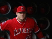 Los Angeles Angels star outfielder Mike Trout stands in the dugout before a game with the Oakland Athletics