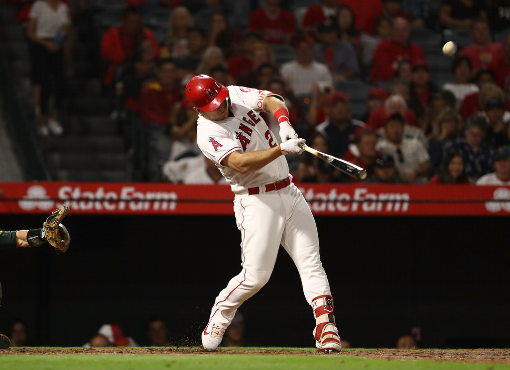 Los Angeles Angels star outfielder Mike Trout hits a two-run home run against the Oakland Athletics
