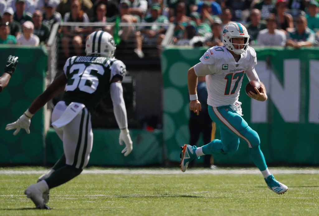 Former Miami Dolphins quarterback Ryan Tannehill rushes the ball against the New York Jets