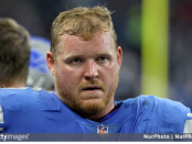 Former Detroit Lions offensive lineman T.J. Lang looks on from the sidelines against the New England Patriots
