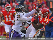Former Baltimore Ravens safety Eric Weddle pushes Spencer Ware out of bounds against the Kansas City Chiefs