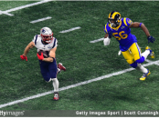 Los Angeles Rams defensive end Dante Fowler Jr. attempts to tackle Julian Edelman against the New England Patriots in Super Bowl LIII