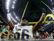 Defensive end Dante Fowler Jr. celebrates after the Los Angeles Rams defeated the New Orleans Saints in the NFC Championship game