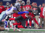 Tampa Bay Buccaneers wide receiver DeSean Jackson is tackled by Jaylon Smith against the Dallas Cowboys