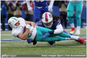Former Miami Dolphins wide receiver Danny Amendola is tackled after making a catch against the Buffalo Bills