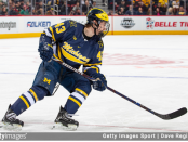 Hockey player Quinn Hughes turns up the ice against the Michigan State Spartans during the annual Duel in the D