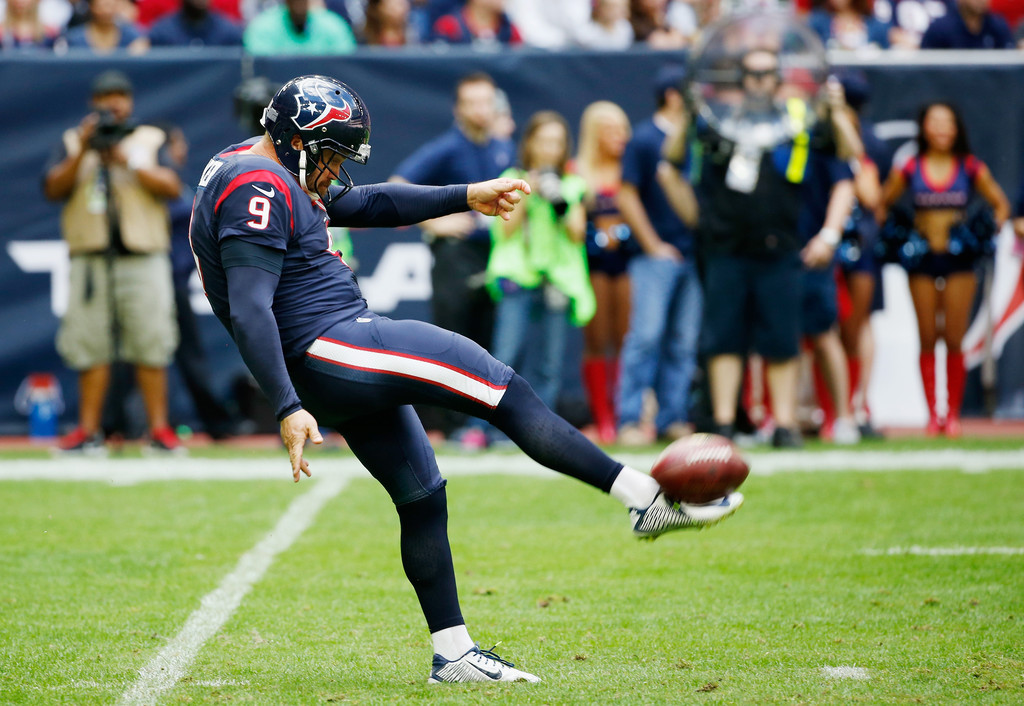 Former Houston Texans punter Shane Lechler punts the football against the Tennessee Titans