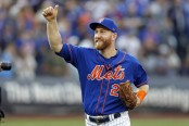 New York Mets third baseman Todd Frazier reacts after defeating the Miami Marlins