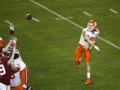 Clemson Tigers quarterback Trevor Lawrence attempts a pass against the Alabama Crimson Tide in the College Football Playoff National Championship