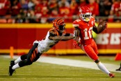Kansas City Chiefs wide receiver Tyreek Hill attempts to avoid being pushed out of bounds by Tony McRae against the Cincinnati Bengals