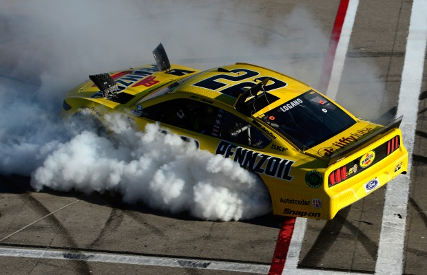 Pennzoil sponsored driver Joey Logano celebrates his win with a burnout at the Monster Energy NASCAR Cup Series Pennzoil Oil 400