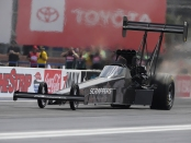 Top Fuel Dragster pilot Mike Salinas racing on Friday at the Denso Spark Plugs NHRA Four-Wide Nationals