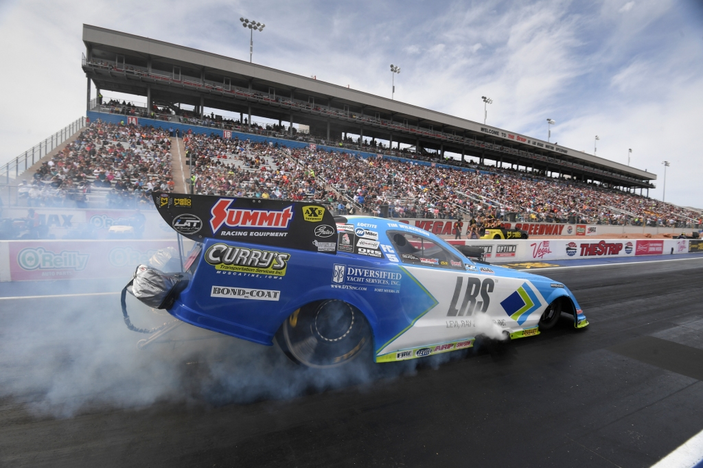 Funny Car pilot Tim Wilkerson racing on Saturday at the DENSO Spark Plugs NHRA Four-Wide Nationals