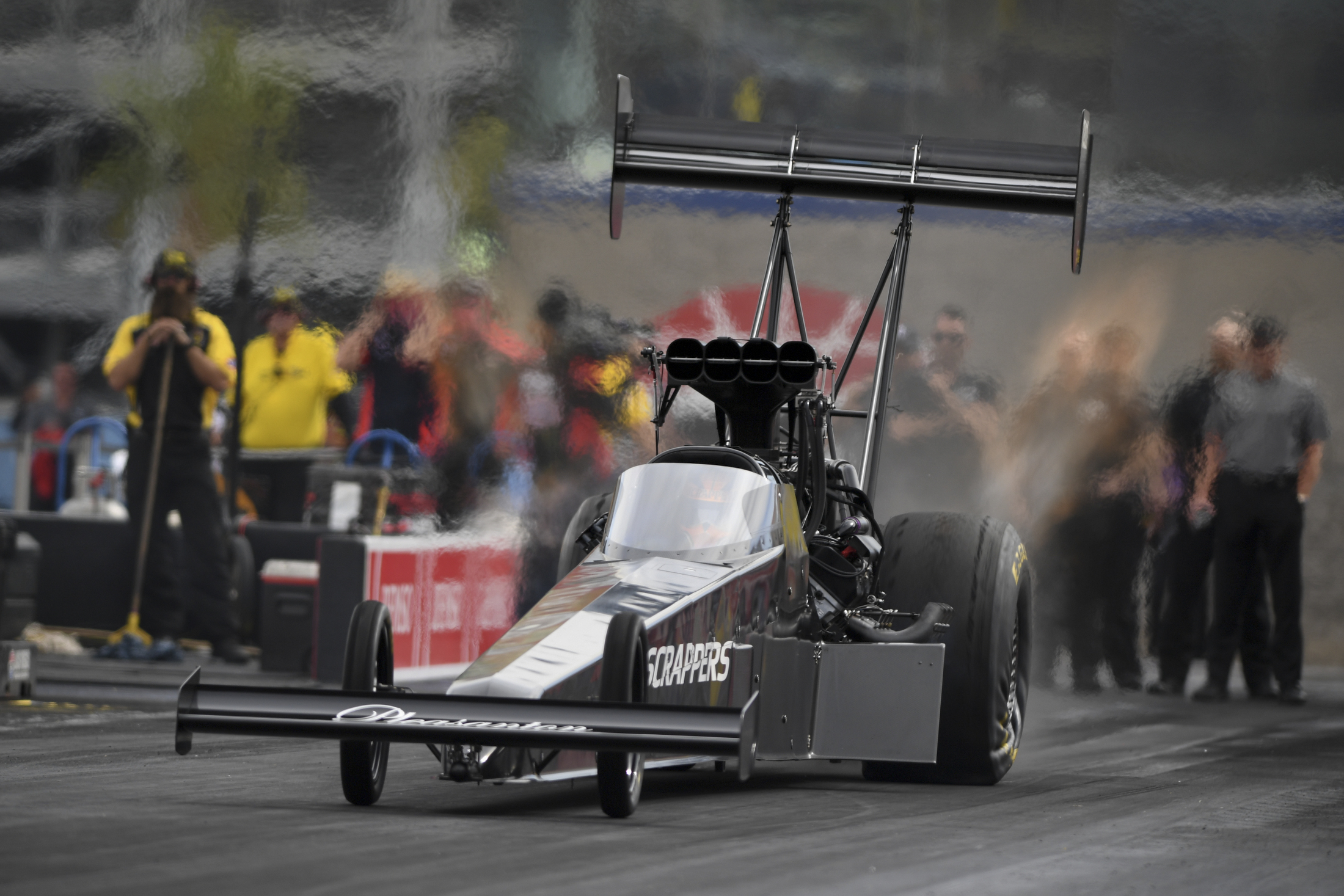 Top Fuel Dragster pilot Mike Salinas racing on Saturday at the DENSO Spark Plugs NHRA Four-Wide Nationals