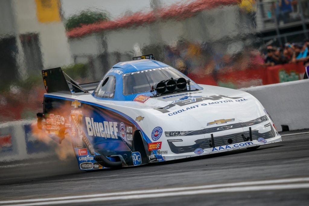 Funny Car pilot John Force racing on Friday at the 32nd annual Mopar Express Lane NHRA SpringNationals presented by Pennzoil