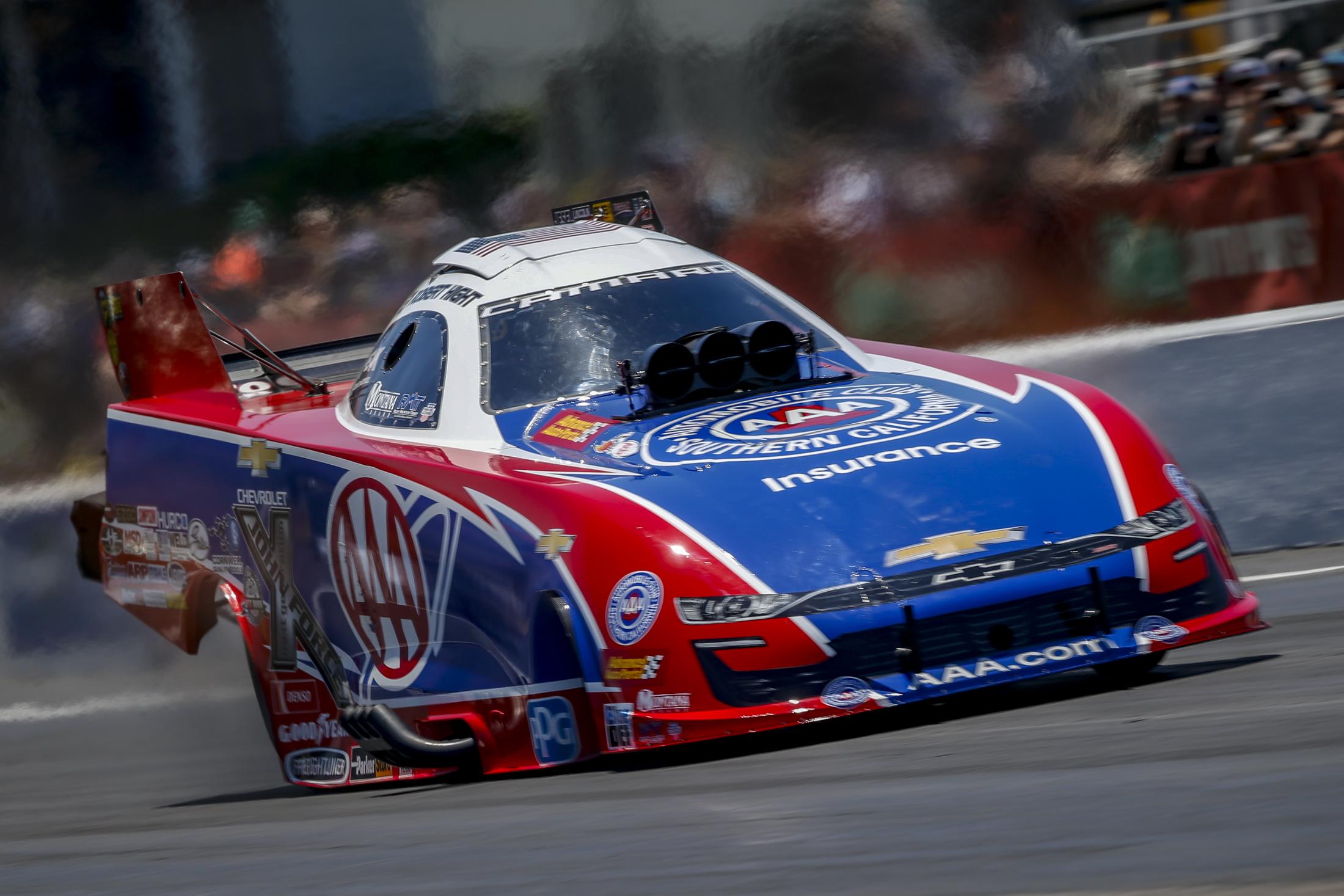 Funny Car pilot Robert Hight racing on Sunday at the 32nd annual Mopar Express Lane NHRA SpringNationals