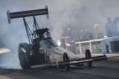 Top Fuel Dragster pilot Mike Salinas racing on Saturday at the NGK Spark Plugs NHRA Four-Wide Nationals