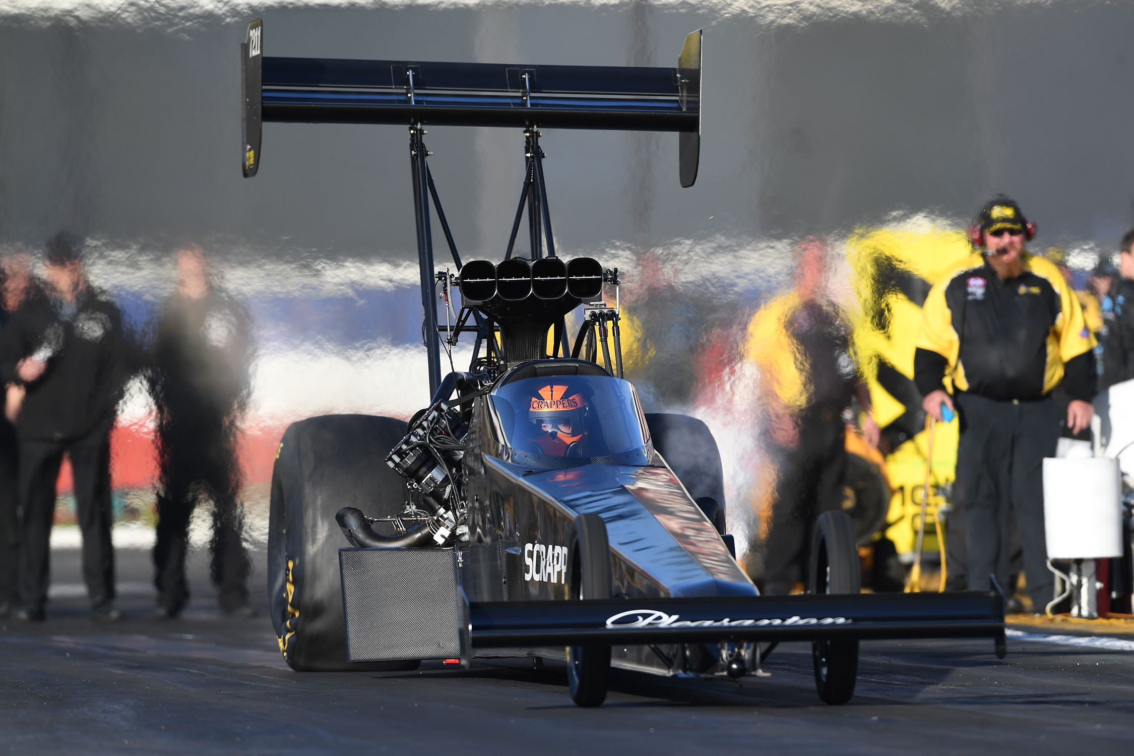 Top Fuel Dragster pilot Mike Salinas racing at the Lucas Oil NHRA Winternationals presented by ProtectTheHarvest.com