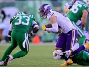 Minnesota Vikings wide receiver Adam Thielen is hit by Jamal Adams after making a reception against the New York Jets