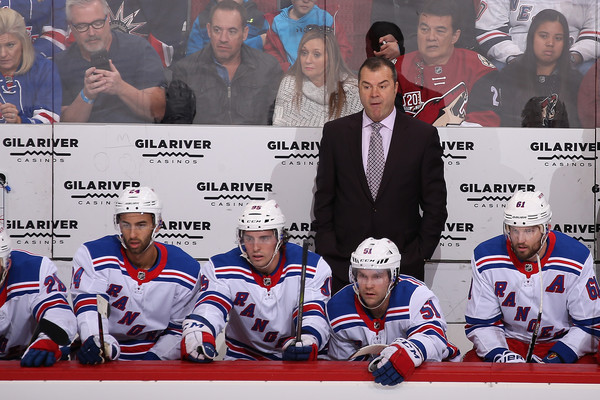 Former New York Rangers head coach Alain Vigneault watches from behind the bench against the Arizona Coyotes