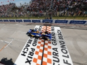 IndyCar driver Alexander Rossi as he crosses the finish line at the Grand Prix of Long Beach